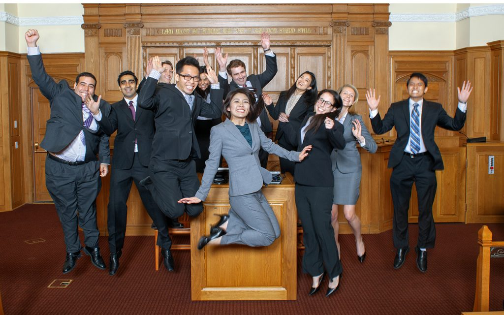 2011-2012 Bulletin Group Picture in Court room people jumping