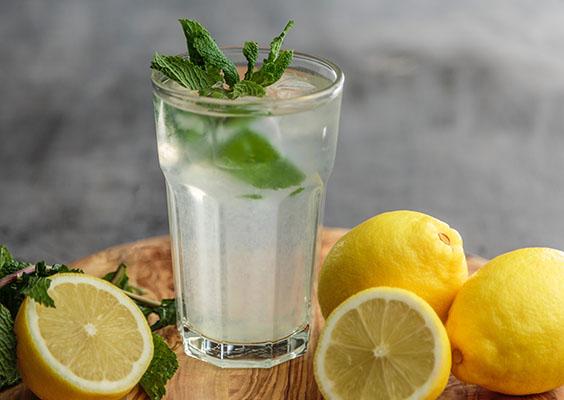 Glass of lemonade and lemons