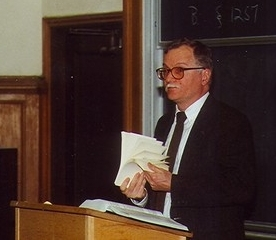 Professor lecturing at podium