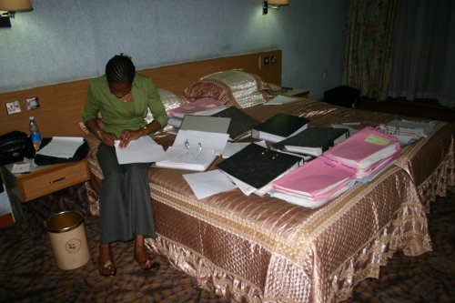Preparing judgments for scanning in a hotel room in Uganda